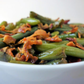 Learn how to make tender braised green beans with bacon!