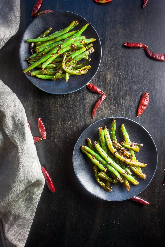 spicy stir fried sichuan green beans with spicy chilies in bowls, stir fried green beans, sichuan green beans