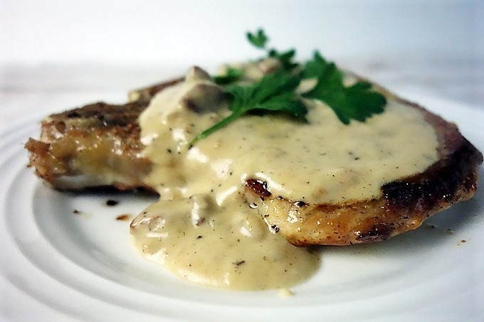 The Best Juicy Fried Pork Chops with Andouille Sausage Cream Gravy