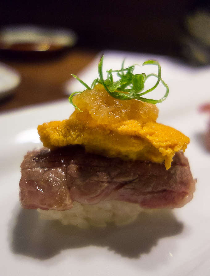 best sushi in san diego, seared A5 wagyu beef sushi topped with uni and garnish