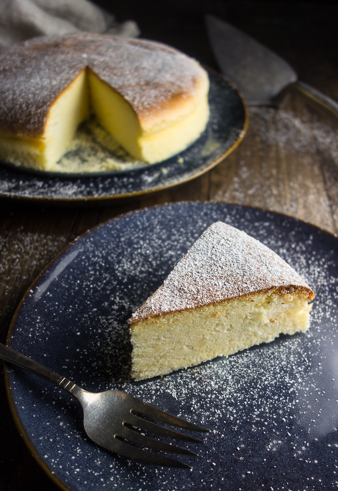 Light & Fluffy Japanese Style Cheesecake, fluffy cheesecake slice sprinkled with powdered sugar
