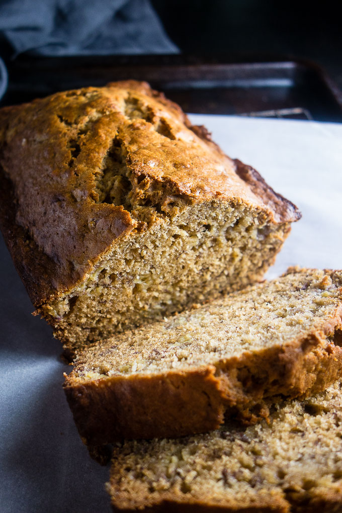 easy caramelized banana bread sliced on a baking rack and parchment paper