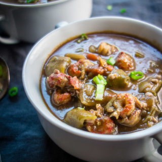 lousiana seafood gumbo with okra, seafood and sausage in roux in a bowl