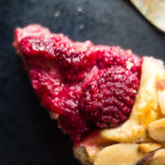 close up of slice of raspberry pie