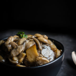 close up of cooked mushrooms in a bowl