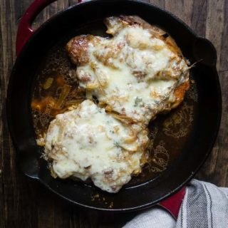 onion and cheese smothered pork chops i a skillet