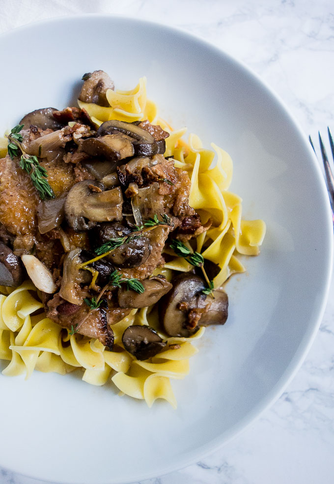 chicken and mushrooms in wine sauce over egg noodles