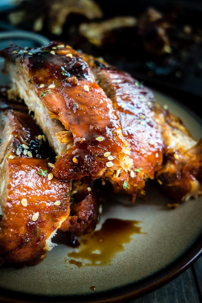 close up of saucy ribs on a plate