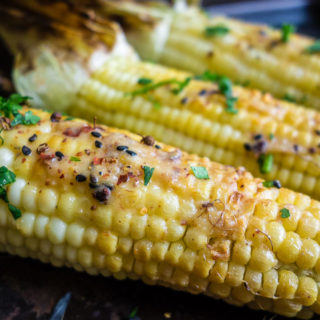 close up of grilled corn with miso butter