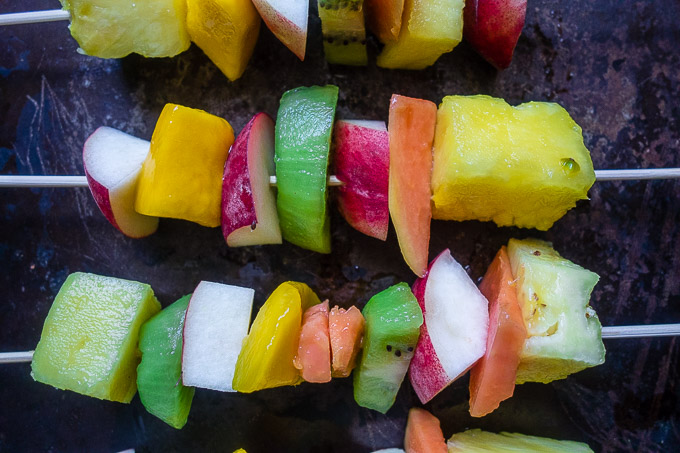 close up photo of fruit on skewers