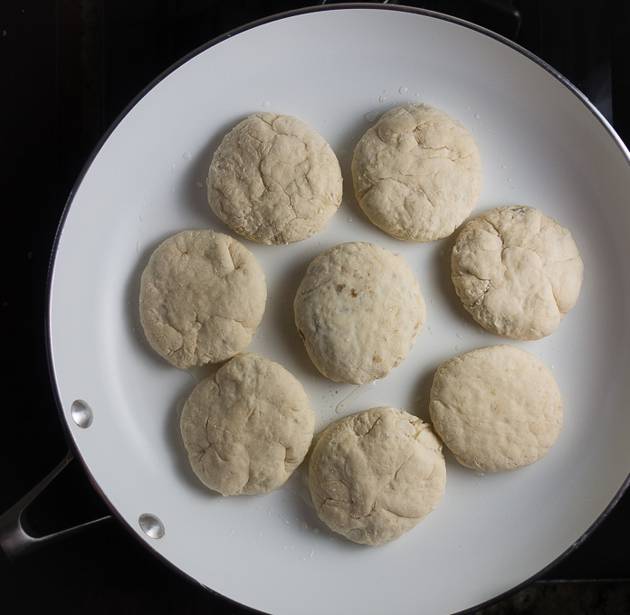 balls of dough in a skillet
