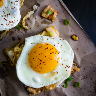 square piece of pizza topped with egg