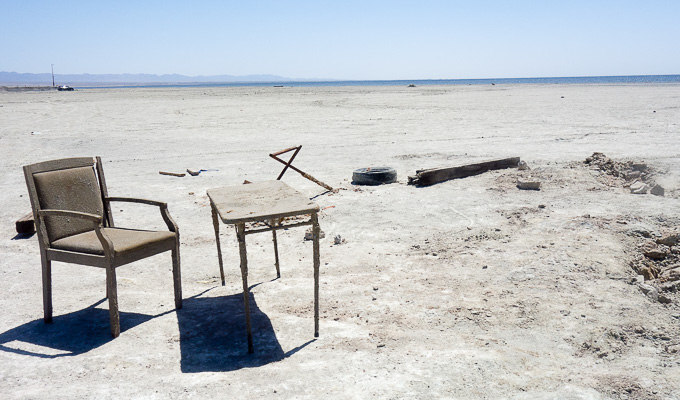 old chair and table on the beach