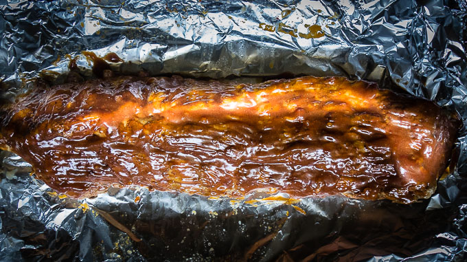 ribs with bbq sauce on foil