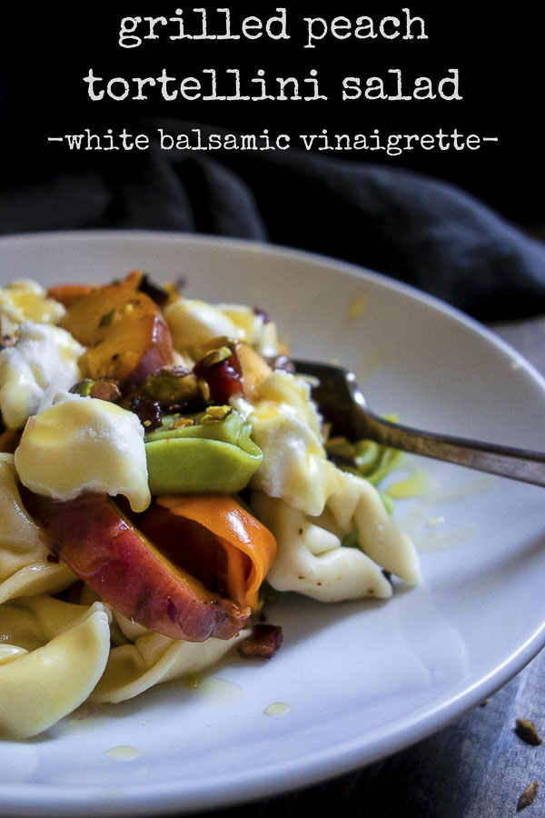 The Grilled Peach Tortellini Salad is made with fresh summer peaches, crispy fried pancetta, pistachios, white balsamic vinaigrette and ricotta cheese and is the BEST SALAD EVER! You'll want to eat this every day.grilled peaches   peach pasta salad   summer fruit salad   tortellini salad   white balsamic vinaigrette   peach and pancetta pasta salad   peach and ricotta   homemade vinaigrette   best peach salad   grilled peach salad   grapefruit vinaigrette
