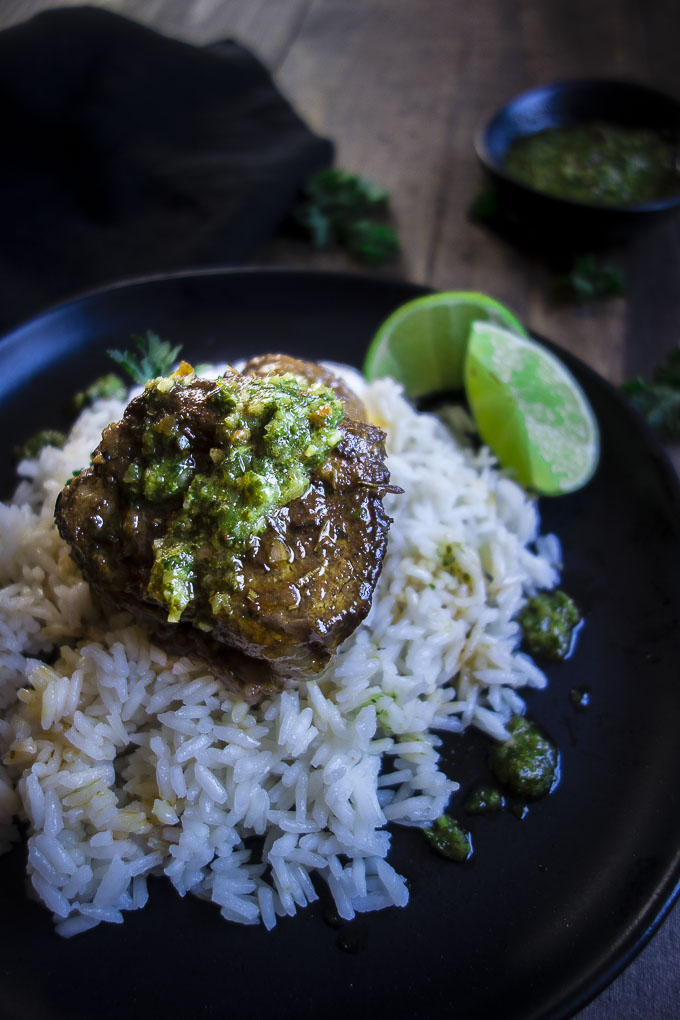 beef short rib with chimichurri sauce on rice with limes