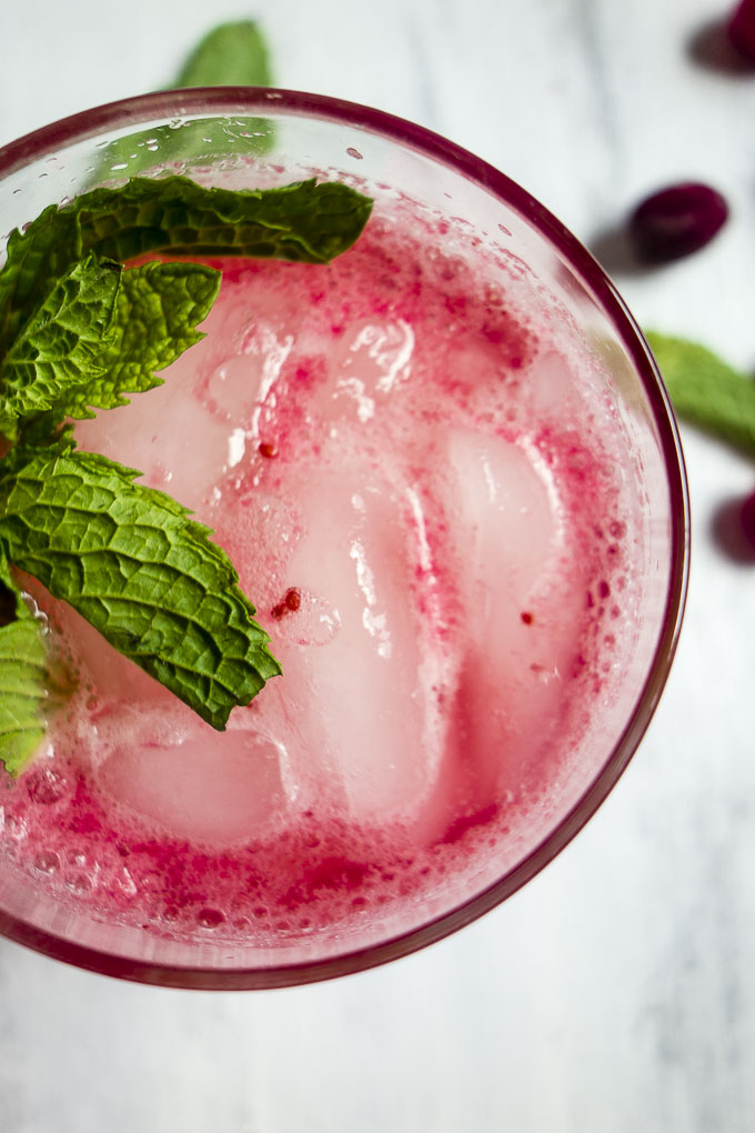 close up of cranberry lemonade with mint
