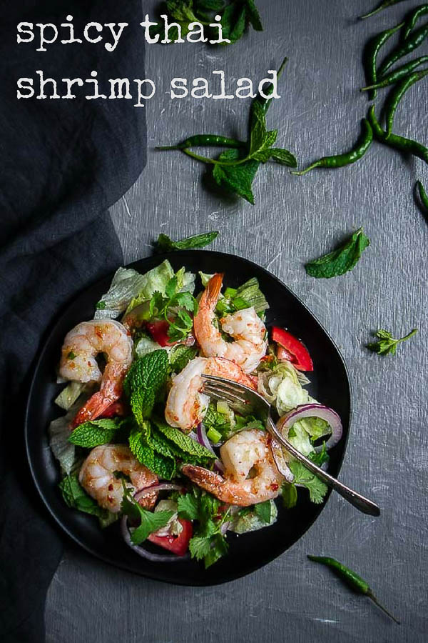 A fresh and healthy Thai Shrimp salad made with fresh herbs, an umami packed Thai salad dressing, topped with juicy succulent shrimp. Perfect for summer!spicy thai salad   fresh shrimp salad   thai salad dressing   healthy thai salad   pla goong   spicy shrimp salad   prawn and chili salad   lemongrass shrimp salad   spicy prawn salad   chili lime dressing