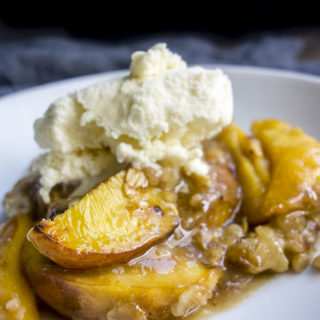 sugar cookie peach cobbler topped with vanilla ice cream