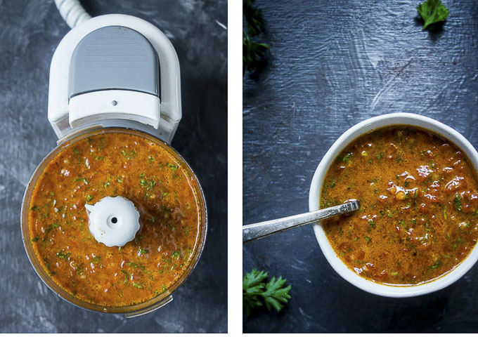red pepper chimichurri sauce in a bowl with a spoon