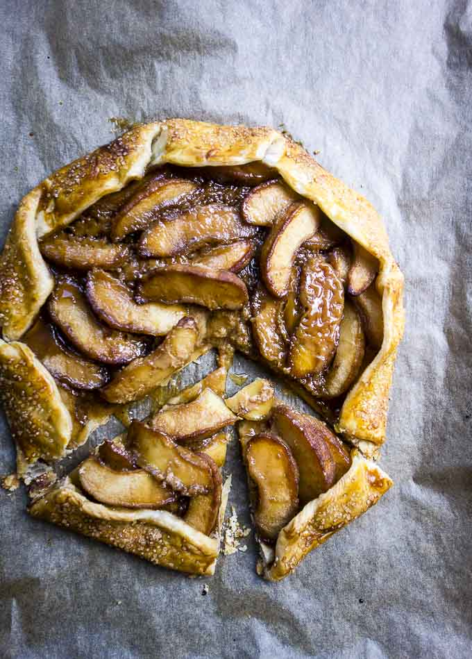 slices of easy salted caramel apple galette on parchment paper