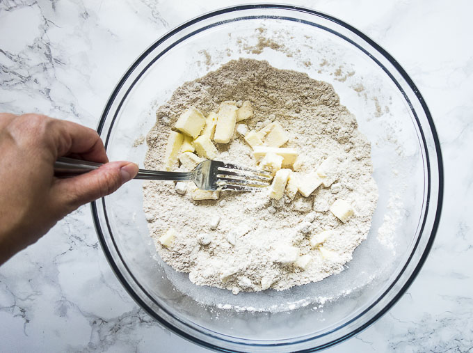butter in flour in a bowl being cut