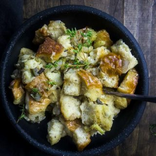 herb stuffing in a bowl with a fork