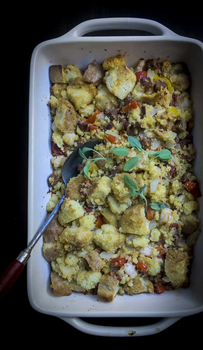 cornbread stuffing recipe in a baking dish with serving spoon