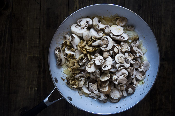 onions butter mushrooms in a skillet